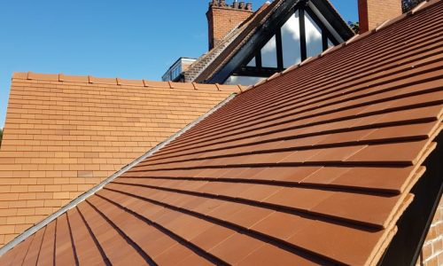 the finished tiled roof by dm roofing in bramhall