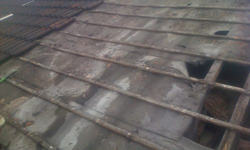 tiles removed from roof in altrincham